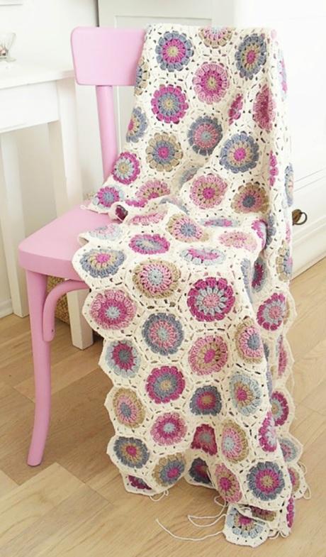 crochet blanket on pink wooden chair