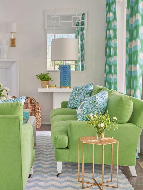 green-sofa-gold-end-table-white-bamboo-mirror